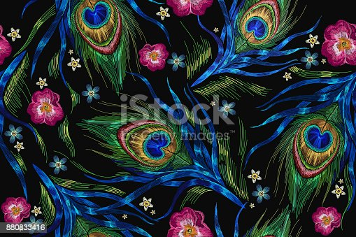 istock Embroidery peacock feathers and roses flowers seamless pattern. Classical fashionable embroidery beautiful peacocks feathers. Fashionable template for design of clothes. Tails of peacocks vector 880833416