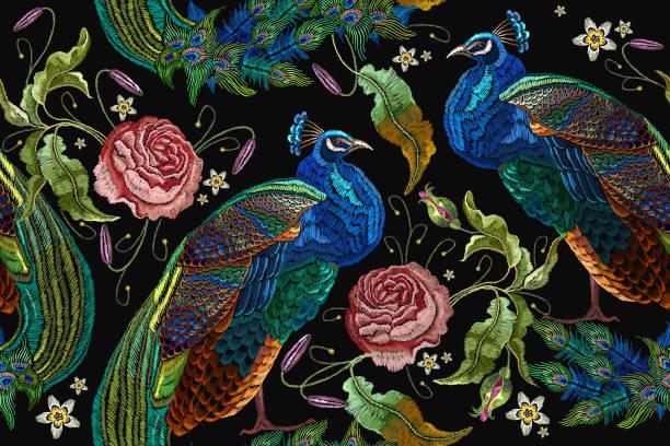 ilustrações de stock, clip art, desenhos animados e ícones de embroidery peacocks and flowers peonies seamless pattern. classical fashionable embroidery beautiful peacocks. fashionable template for design of clothes. tails of peacocks and roses - pena de pássaro algodão