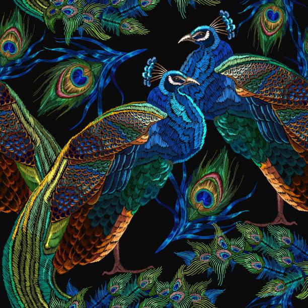 ilustrações de stock, clip art, desenhos animados e ícones de embroidery peacocks seamless pattern. classical fashionable embroidery beautiful peacocks. fashionable template for design of clothes. tails of peacocks - pena de pássaro algodão