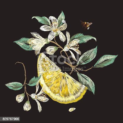Embroidery traditional floral pattern with branch of  flowers and lemon.