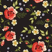 Embroidery traditional folk seamless pattern with red roses and strawberry.