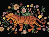 Embroidery traditional folk seamless pattern with tiger and flowers.