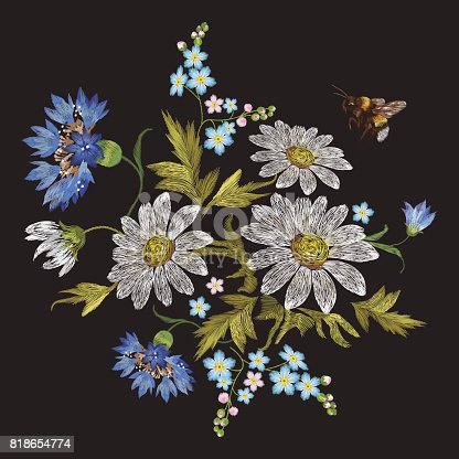 Embroidery trend floral pattern with chamomiles, cornflowers and bee.