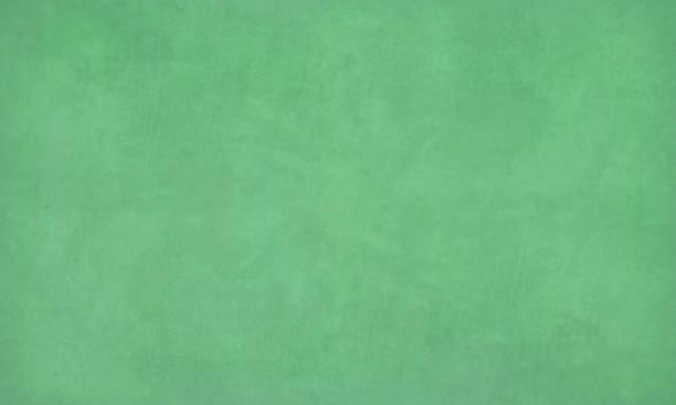 szmaragdowo-zielony kolor porysowany efekt jasnej tekstury ściany wektorowe tło- poziome - ilustracja zielonej tablicy kredowej, tablicy - drewno tworzywo stock illustrations