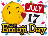 Cute emoticon sending love at you with floating heart and loose-leaf calendar under a confetti shower reminding at you World Emoji Day in July 17.