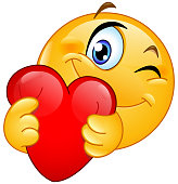 Winking emoticon hugging a red heart