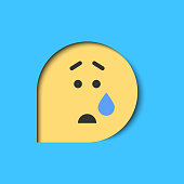 Vector illustration of an emoticon in a speech bubble and a paper art cut out effect.