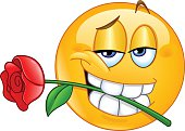 Charming emoticon holding rose flower between teeth in mouth