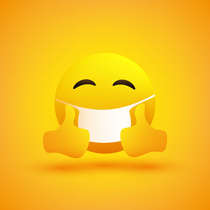 Emoticon with Winking Eye, Showing Thumbs Up and Wearing Medical Mask
