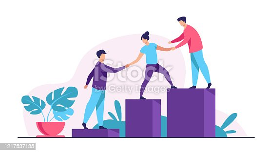 istock Employees giving hands and helping colleagues to walk upstairs 1217537135