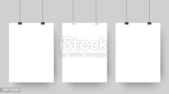 Empty affiche mockup hanging on paper clips. White blank advertising poster template casts shadow on gray background. three canvas photo sheets vector illustration