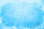 istock Empty blank light sky blue gradient coloured grunge textured blotched and smudged vector backgrounds like an oil painting 1325419541