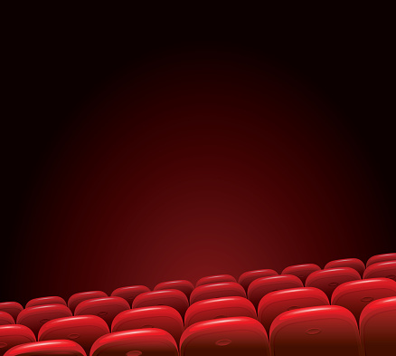 Empty cinema with red seats on a dark background