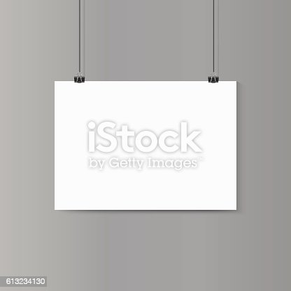 istock Empty horizontal white paper poster mockup on grey wall with 613234130