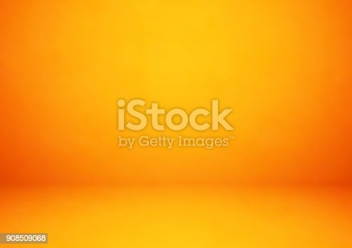 Empty orange studio room, used as background for display your products