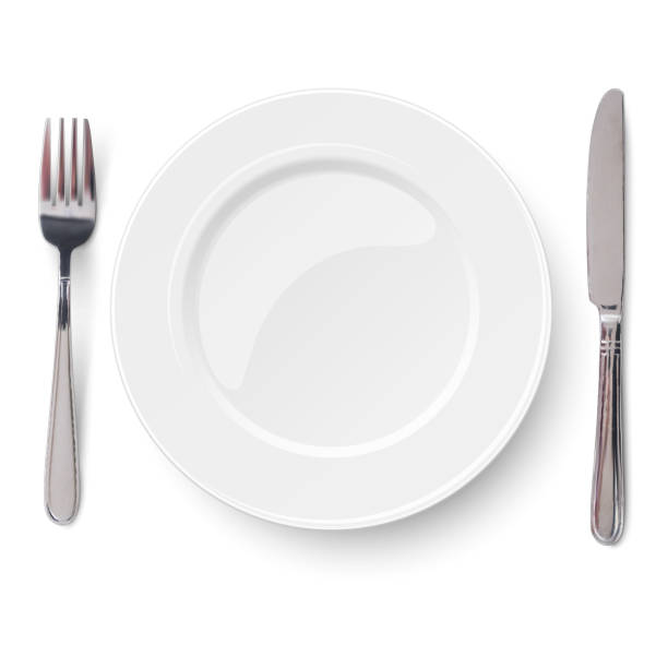 illustrazioni stock, clip art, cartoni animati e icone di tendenza di empty plate with knife and fork isolated on a white background. view from above. - coltello posate