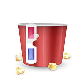 empty popcorn bucket and 3d glasses on white background
