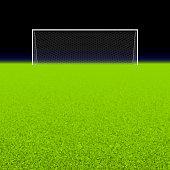 Empty white soccer net on grassy green field