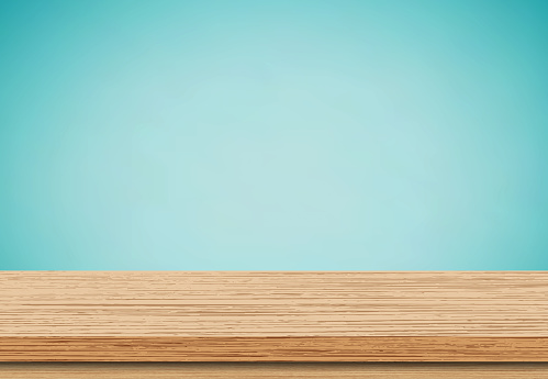Empty wood table top blue background