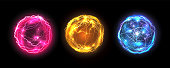 istock Energy balls and plasma sphere, vector electric lightning and light flash sparks. Magic lightning discharge, red pin, blue purple and golden yellow color realistic energy balls, electric light burst 1223943751