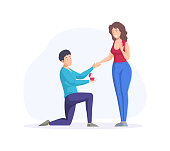 istock Engagement proposal surprise. Enamored man stands on knee proposing to woman 1340664891