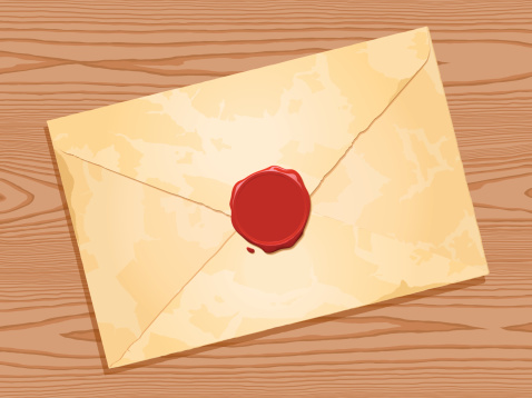envelope with wax seal wood background