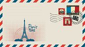 an envelope with a postage stamp with Arc de Triomphe, the Eiffel tower and the flag of France