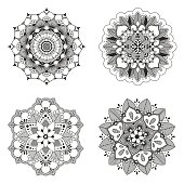 Set of four lace floral mandala for design or mehndi, lace lotus, hand drawn vector illustration