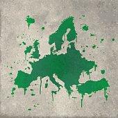 Europe map graffiti green splats on wall