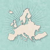 Map of Europe in a trendy vintage style. Beautiful retro illustration with old textured paper and light rays in the background (colors used: blue, green, beige and black for the outline). Vector Illustration (EPS10, well layered and grouped). Easy to edit, manipulate, resize or colorize.
