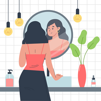Everyday personal care, skincare daily routine, girl stands in front of a mirror in the bathroom and looks at herself in reflection