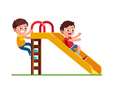 Excited preschool boy kid sliding down slide and happy friend climbing up ladder. Children cartoon character flat vector clipart illustration.