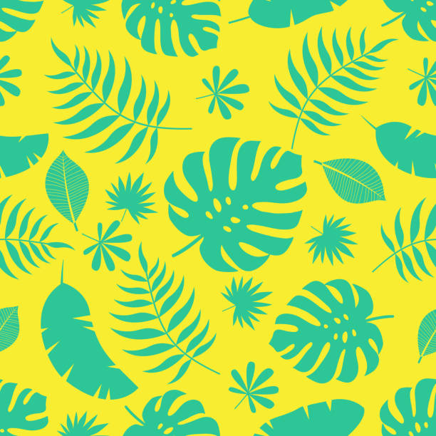 Exotic seamless colorful bright pattern with green tropical jungle leaves silhouettes on yellow background. Floral modern pattern for textile, manufacturing etc. Vector illustration tropical pattern stock illustrations