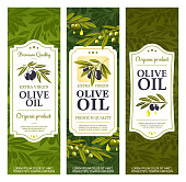 Olive oil bottle package labels, organic extra virgin olives. Vector Spanish, Greek and Italian premium quality natural olive oil banners with stars, drops and green leaves