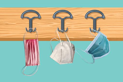 Illustration of face masks hanging on a coat rack in the school hallway