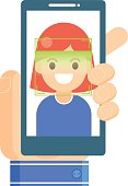 Face recognition and mobile identification.  Young woman unlocking her smartphone, or app