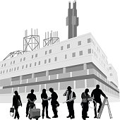 A vector silhouette illustration of a fectory building exterior with people in front. Workers include a business woman, delivery man, admin, construction workers, electrician, and man on a ladder.  The buidlign is industrial looking with antenna on top.