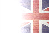A grungy faded vector illustration of Britain flag. The right is bright with flag design while the left is faded and weathered white for copy space. Apt for use posters, backdrops, banners, greeting cards templates or patriotic t shirt designs.