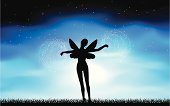 Silhouette of a fairy in the moonlight.