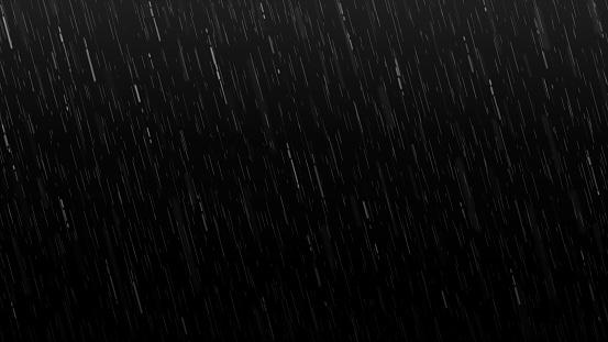 Falling raindrops isolated on black background