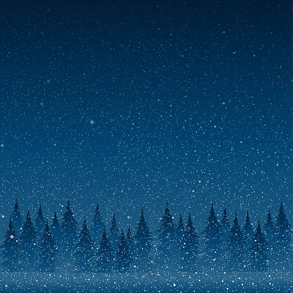 Falling white snow with blue winter sky and forest.
