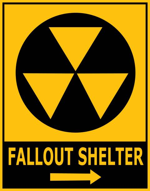 Fallout Shelter Sign Vector illustration of gold and black fallout shelter sign. bomb shelter stock illustrations