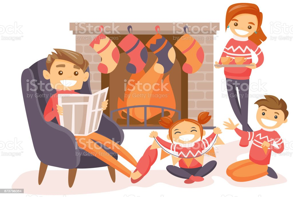 Family celebrating Christmas by the fireplace