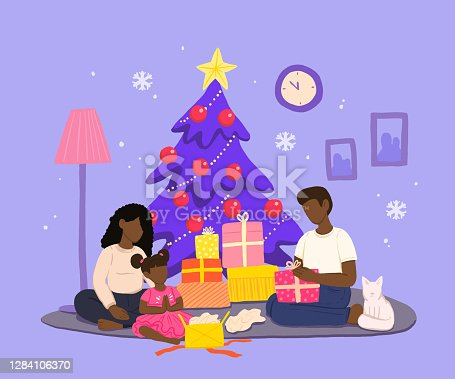 istock Family Celebrating Christmas in Cozy Home Environment with Presents 1284106370