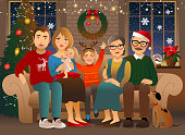 Family sitting on a sofa. Christmas decorations and warm cozy atmosphere.