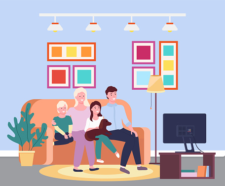 Family evening at the tv. Four member family smiling sitting io the sofa in front of the televisor