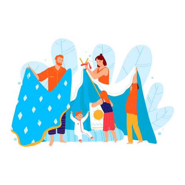 bildbanksillustrationer, clip art samt tecknat material och ikoner med familj kul spendera tid, förälder bygga plaything tält från filt isolerade på vit, tecknad vektor illustration. far mor underhålla barn. - cosy pillows mother child