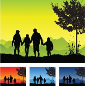 A family in silhouette all holding hands. Three extra color schemes are provided showing different times of the year and day. The night color scheme also includes stars.
