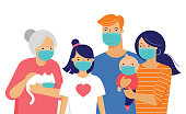 istock Family, mother, father, baby and a girl wearing medical masks during coronavirus outbreak. Covid-19 concept. Self isolation, quarantine. Vector flat style illustration 1217481357