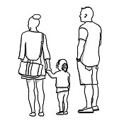 A little girl holding her mother's hand with her father beside her